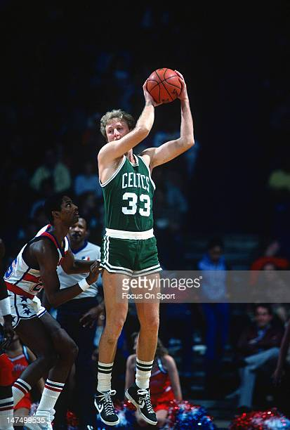 Larry Bird of the Boston Celtics is guarded closely by Darren Daye of the Washington Bullets during an NBA basketball game circa 1983 at the Capital...