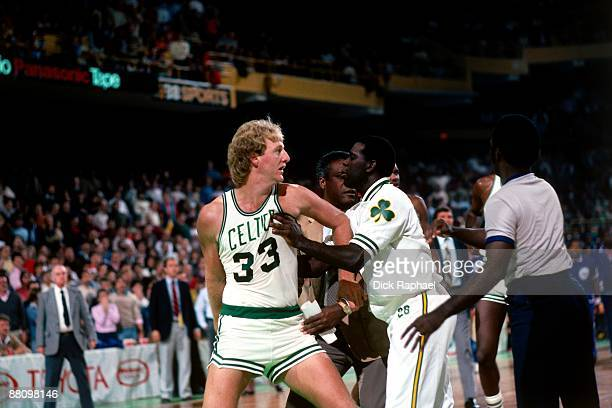 Larry Bird of the Boston Celtics is restrained by a teammate during a game in 1984 the Boston Garden in Boston Massachusetts NOTE TO USER User...