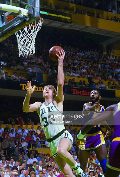 Larry Bird of the Boston Celtics lays the ball up in front of James Worthy of the Los Angeles Lakers during the NBA Finals June 1985 at The Boston...