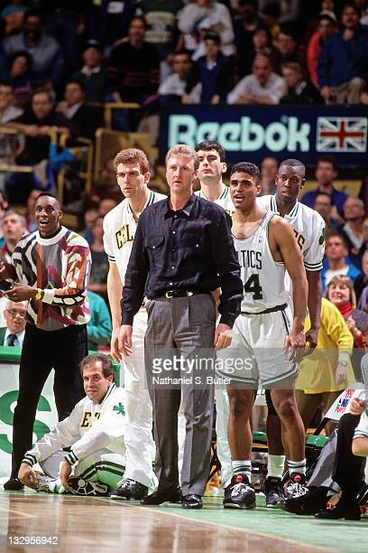 Larry Bird of the Boston Celtics looks on from the bench circa 1991 at the Boston Garden in Boston Massachusetts NOTE TO USER User expressly...