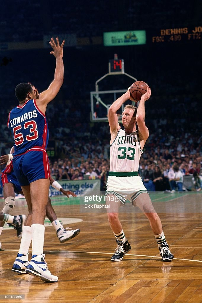 Larry Bird #33 of the Boston Celtics looks to make a move against James Edwards #53 of the Detroit Pistons during a game played in 1987 at the Boston Garden in Boston, Massachusetts.