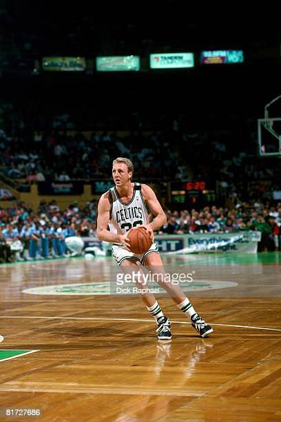 Larry Bird of the Boston Celtics looks to make a move during a game circa 1990 at the Boston Garden in Boston Massachusetts NOTE TO USER User...