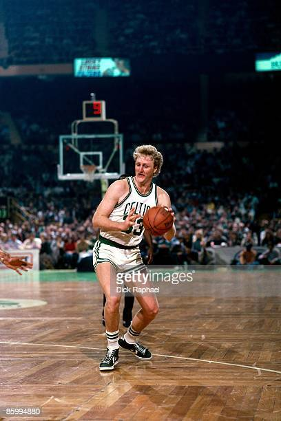 Larry Bird of the Boston Celtics looks to make a move during a game played in 1983 at the Boston Garden in Boston Massachusetts NOTE TO USER User...