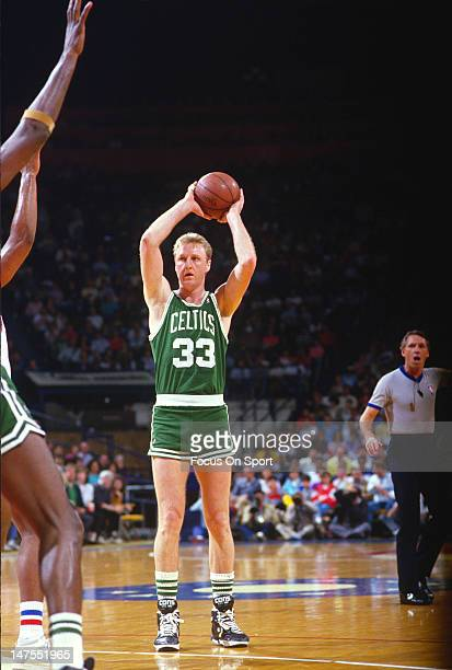 Larry Bird of the Boston Celtics looks to make a pass against the Washington Bullets during an NBA basketball game circa 1983 at the Capital Center...