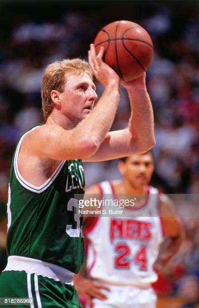 Larry Bird of the Boston Celtics looks to pass against the New Jersey Nets during a game at the Brendan Byrne Arena in East Rutherford New Jersey...