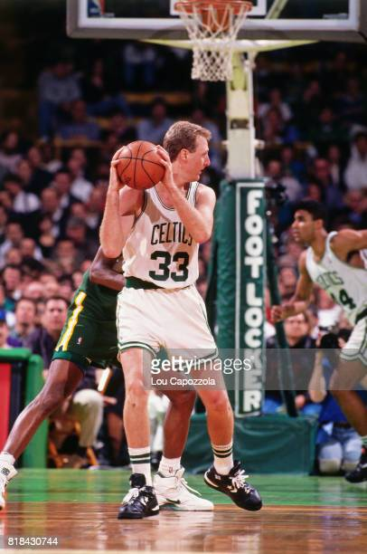 Larry Bird of the Boston Celtics looks to pass against the Seattle SuperSonics at Boston Garden in Boston Massachusetts circa 1991 NOTE TO USER User...