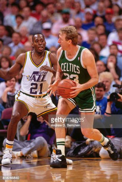 Larry Bird of the Boston Celtics looks to pass against Tony Brown of the Utah Jazz during a game at the Delta Center in Salt Lake City Utah circa...