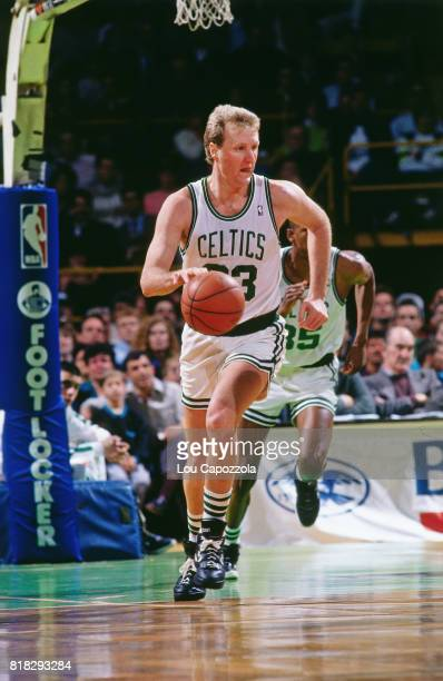 Larry Bird of the Boston Celtics looks to pass during a game at the Boston Garden in Boston Massachusetts circa 1990 NOTE TO USER User expressly...