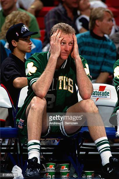 Larry Bird of the Boston Celtics looks upset while sitting on the bench during an NBA game in 1991 NOTE TO USER User expressly acknowledges and...