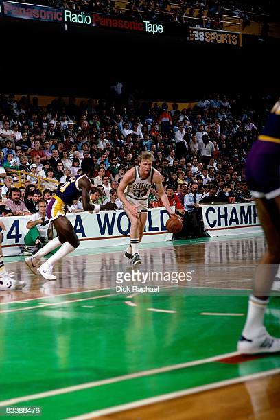 Larry Bird of the Boston Celtics makes a move to the basket against Michael Cooper of the Los Angeles Lakers during the 1984 NBA Finals played circa...