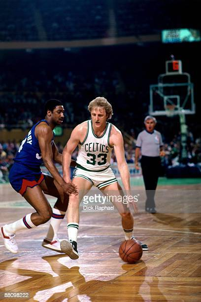 Larry Bird of the Boston Celtics moves the ball up court against Bill Willoughby of the New Jersey Nets during a game played in 1984 at the Boston...