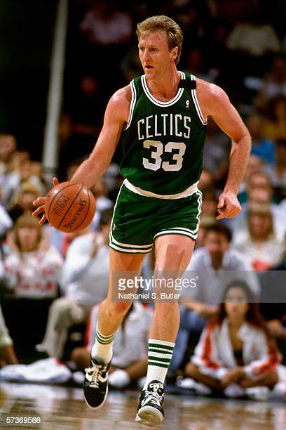 Larry Bird of the Boston Celtics moves the ball up court during a game played in 1990 at the Boston Garden in Boston, Massachusetts. NOTE TO USER:...