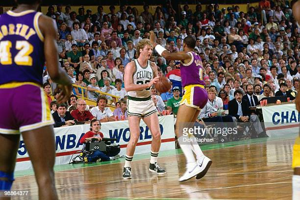 Larry Bird of the Boston Celtics passes against Byron Scott of the Los Angeles Lakers during the 1985 NBA Finals at the Boston Garden in Boston...
