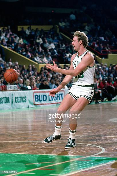 Larry Bird of the Boston Celtics passes during a game played in 1983 at the Boston Garden in Boston Massachusetts NOTE TO USER User expressly...