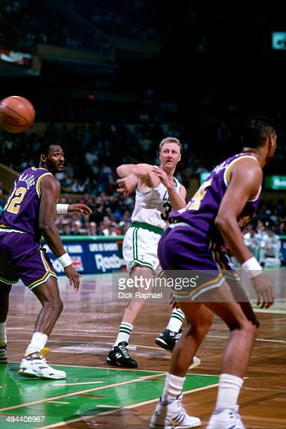 Larry Bird of the Boston Celtics passes the ball against the Karl Malone of the Utah Jazz during a game played in 1992 at the Boston Garden in Boston...