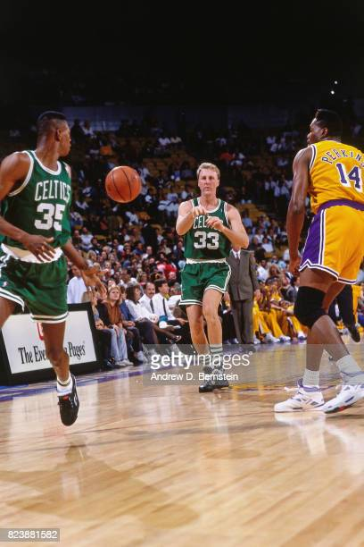 Larry Bird of the Boston Celtics passes the ball against the Los Angeles Lakers at the Great Western Forum in Inglewood California circa 1991 NOTE TO...