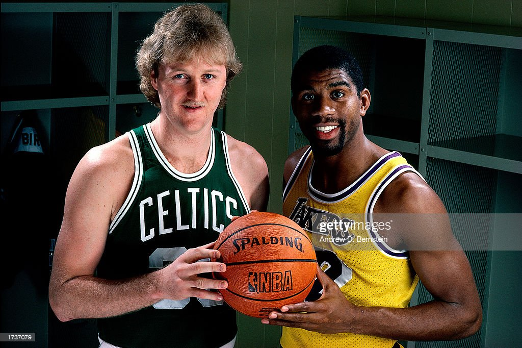 Larry Bird #33 of the Boston Celtics poses for a portrait with Magic Johnson of the Los Angeles Lakers at the Great Western Forum on January 1, 1983 in Los Angeles, California.