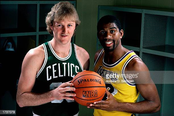 Larry Bird of the Boston Celtics poses for a portrait with Magic Johnson of the Los Angeles Lakers at the Great Western Forum on January 1, 1983 in...