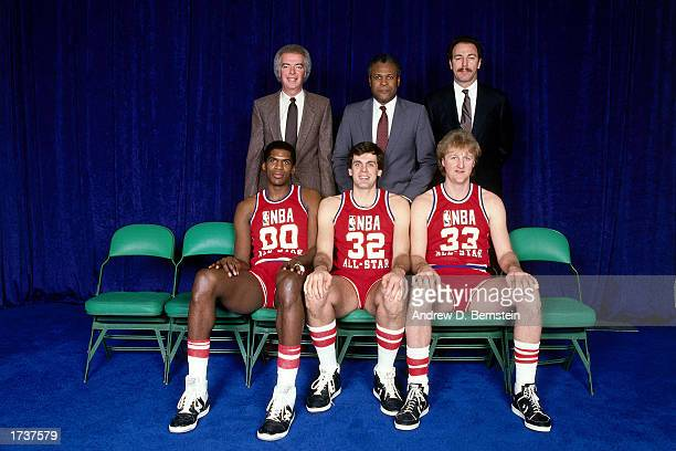 Larry Bird of the Boston Celtics poses with Robert Parish and Kevin McHale along with his coaches Jimmy Rogers KC Jones and Chris Ford during the...