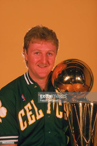 Larry Bird of the Boston Celtics poses with the NBA Championship Trophy circa the 1980's.