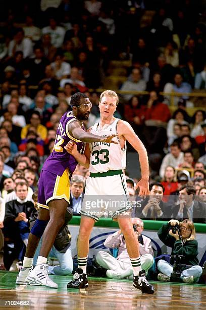 Larry Bird of the Boston Celtics posts up James Worthy of the Los Angeles Lakers during a game circa 1992 at the Boston Garden in Boston...