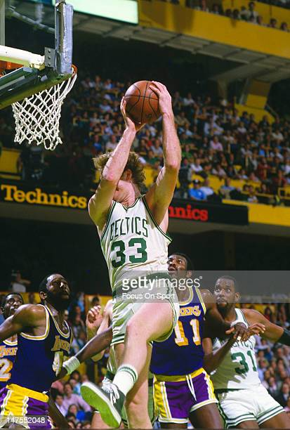 Larry Bird of the Boston Celtics pulls down a rebound against the Los Angeles Lakers during the 1984 NBA Finals June 1984 at The Boston Garden in...