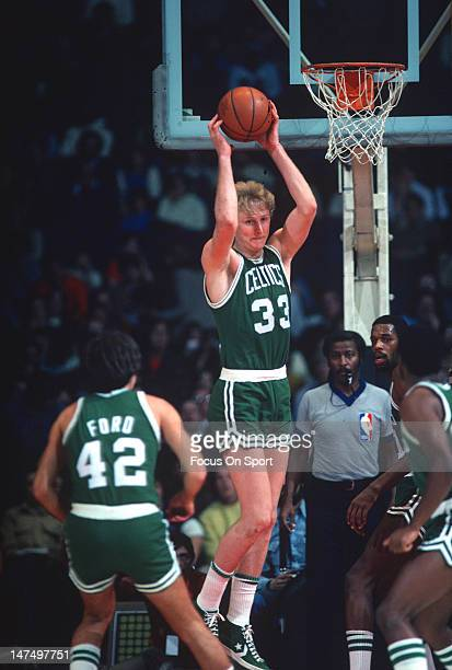 Larry Bird of the Boston Celtics pulls down a rebound against the Washington Bullets during an NBA basketball game circa 1985 at the Capital Center...