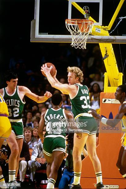 Larry Bird of the Boston Celtics rebounds the ball during a game against the Los Angeles Lakers in 1984 at the Great Western Forum in Los Angeles...