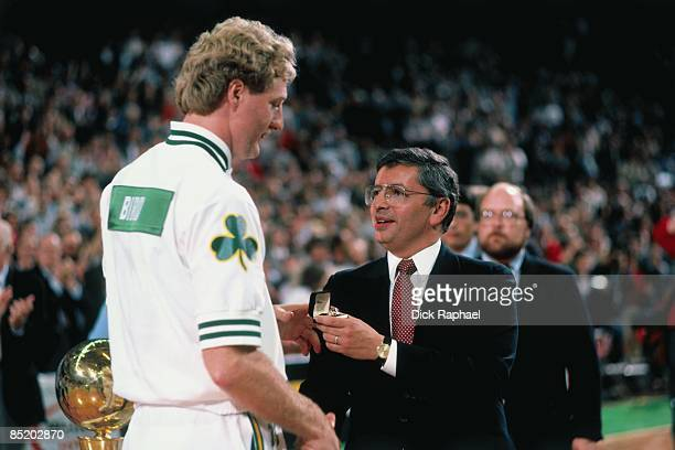 Larry Bird of the Boston Celtics receives his ring from NBA Commissioner David Stern during the Celtics 1984 Championship ring ceremony prior to...