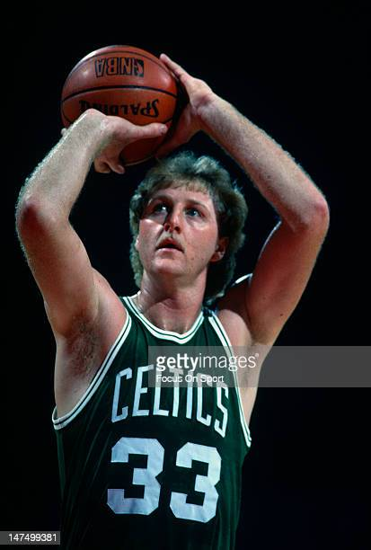 Larry Bird of the Boston Celtics shoots a freethrow against the Washington Bullets during an NBA basketball game circa 1983 at the Capital Center in...
