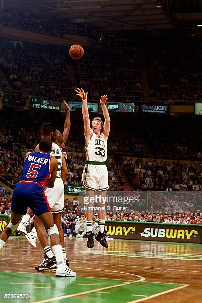Larry Bird of the Boston Celtics shoots a jump shot against Isiah Thomas of the Detroit Pistons during a game circa 1991 at the Boston Garden in...