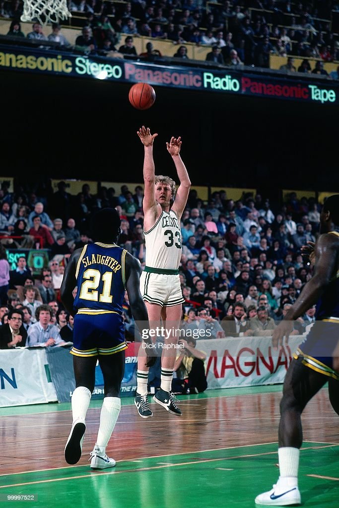 Larry Bird #33 of the Boston Celtics shoots a jump shot against Jose Slaughter #21 of the Indiana Pacers during a game played in 1983 at the Boston Garden in Boston, Massachusetts.