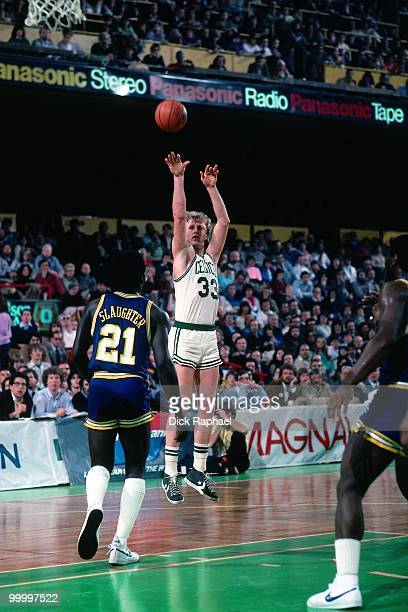 Larry Bird of the Boston Celtics shoots a jump shot against Jose Slaughter of the Indiana Pacers during a game played in 1983 at the Boston Garden in...
