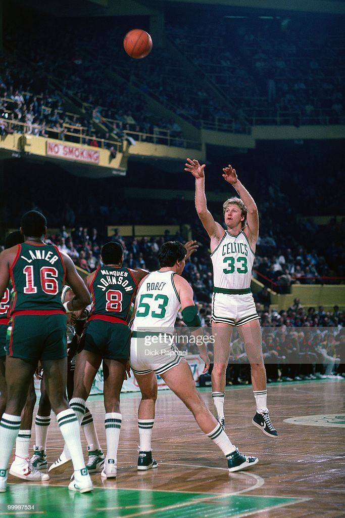Larry Bird #33 of the Boston Celtics shoots a jump shot against the Milwaukee Bucks during a game played in 1983 at the Boston Garden in Boston, Massachusetts.