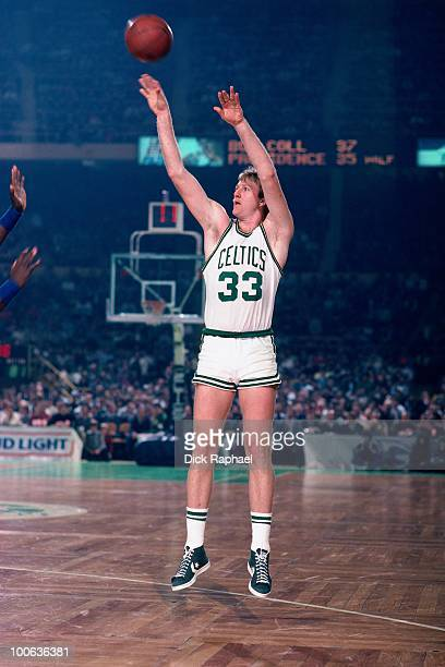 Larry Bird of the Boston Celtics shoots a jump shot during a game played in 1984 at the Boston Garden in Boston Massachusetts NOTE TO USER User...