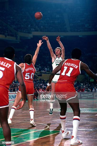 Larry Bird of the Boston Celtics shoots a jump shotagainst Ben Poquette of the Cleveland Cavaliers during a game played in 1984 at the Boston Garden...