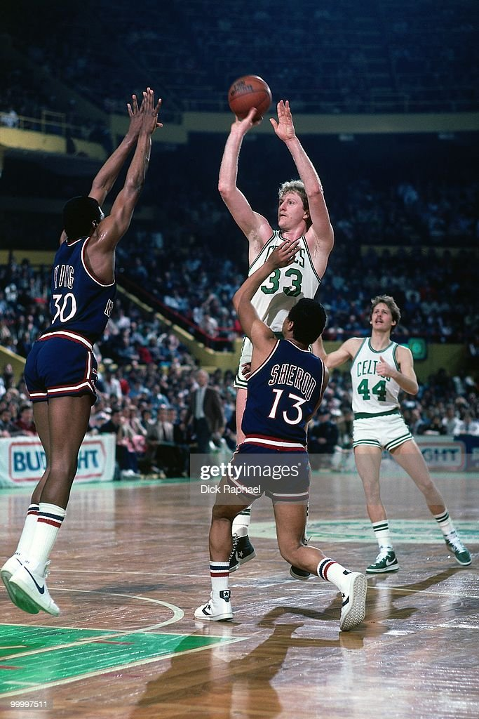 Larry Bird #33 of the Boston Celtics shoots a jumper against Bernard King #30 of the New York Knicks during a game played in 1983 at the Boston Garden in Boston, Massachusetts.