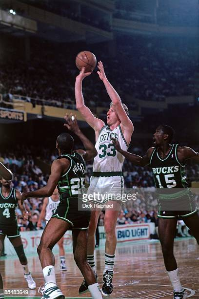 Larry Bird of the Boston Celtics shoots a jumper against the Milwaukee Bucks during a game played in 1987 at the Boston Garden in Boston...