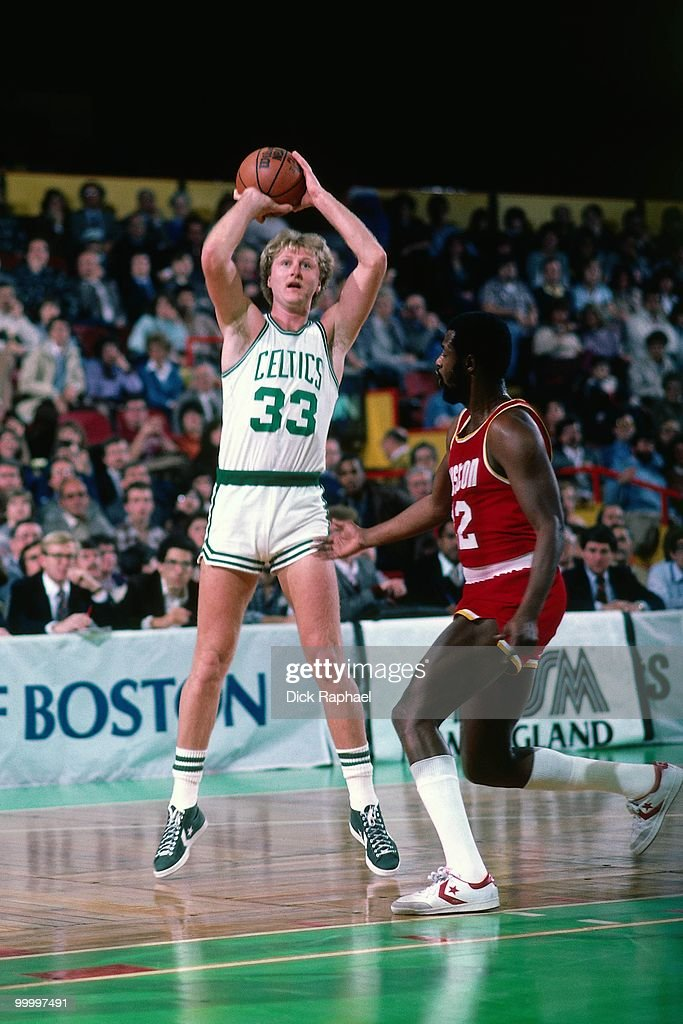 Larry Bird #33 of the Boston Celtics shoots a jumper against the Houston Rockets during a game played in 1983 at the Boston Garden in Boston, Massachusetts.