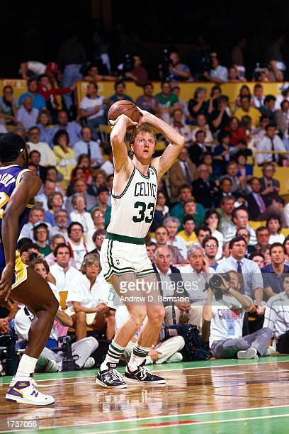 Larry Bird of the Boston Celtics shoots a jumpshot against James Worthy of the Los Angeles Lakers during the NBA game at The Boston Garden on January...