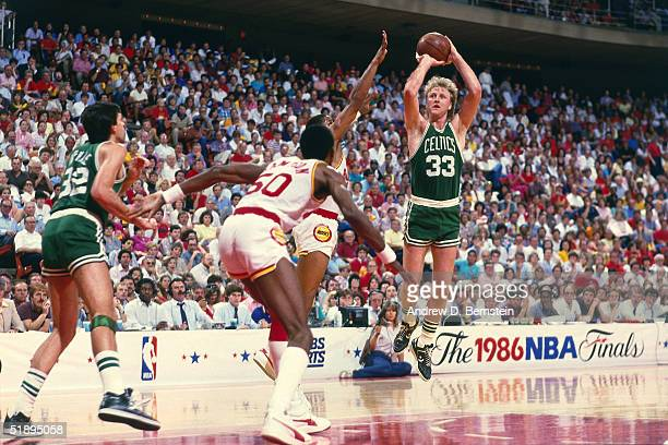 Larry Bird of the Boston Celtics shoots a jumpshot over a Houston Rockets defender during the 1986 NBA Finals at the Summit on June 1, 1986 in...