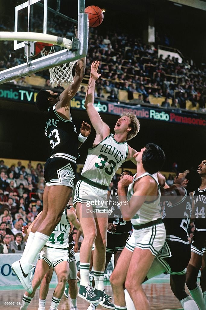Larry Bird #33 of the Boston Celtics shoots a layup against Artis Gilmore #53 of the San Antonio Spurs during a game played in 1983 at the Boston Garden in Boston, Massachusetts.
