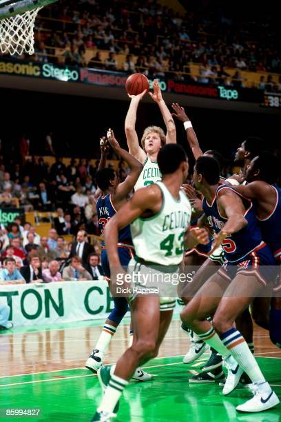 Larry Bird of the Boston Celtics shoots against Bernard King of the New York Knicks during a game played in 1983 at the Boston Garden in Boston...