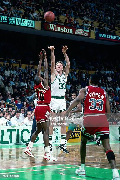 Larry Bird of the Boston Celtics shoots against BJ Armstrong of the Chicago Bulls during a game played circa 1990 at the Boston Garden in Boston...