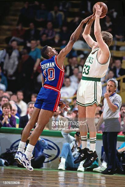 Larry Bird of the Boston Celtics shoots against Dennis Rodman of the Detroit Pistons at the Boston Garden in Boston Massachusetts circa 1991 NOTE TO...