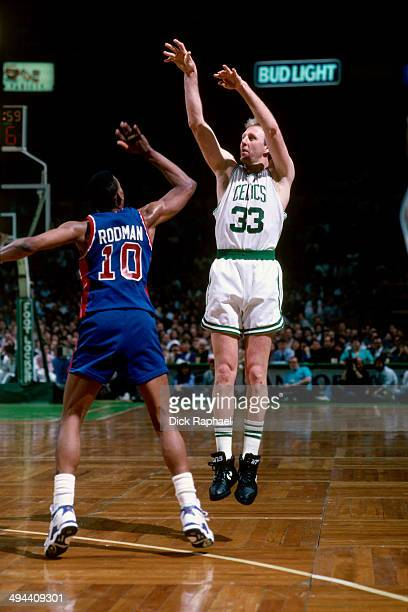 Larry Bird of the Boston Celtics shoots against Dennis Rodman of the Detroit Pistons during a game in 1992 at the Boston Garden in Boston...