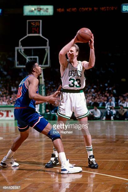 Larry Bird of the Boston Celtics shoots against Hot Rod Williams of the New Jersey Nets during a game in 1992 at the Boston Garden in Boston...