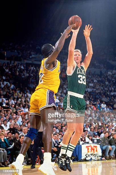 Larry Bird of the Boston Celtics shoots against James Worthy of the Los Angeles Lakers circa 1991 at the Great Western Forum in Inglewood California...
