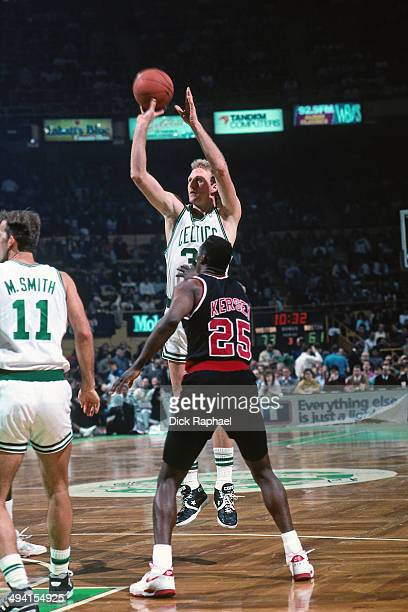 Larry Bird of the Boston Celtics shoots against Jerome Kersey of the Portland Trail Blazers during a game played circa 1990 at the Boston Garden in...