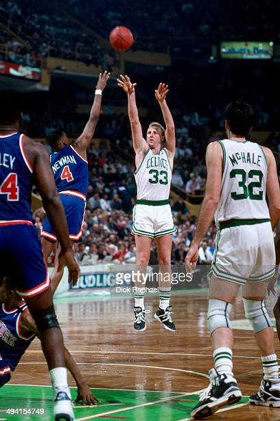 Larry Bird of the Boston Celtics shoots against Johnny Newman of the New York Knicks during a game played circa 1990 at the Boston Garden in Boston...